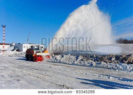 NIZHNY NOVGOROD. RUSSIA. FEBRUARY 17, 2015. The rotor ZAUGG snowplow far rejects snow from a roadsid