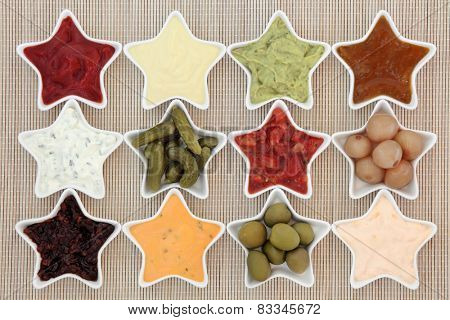 Selection of dips for snacks in star shaped dishes over bamboo background.
