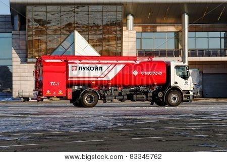 NIZHNY NOVGOROD. RUSSIA. FEBRUARY 17, 2015. Bright red fuel truck of the company Lukoil