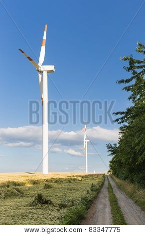 Wind Turbines Next To Country Road