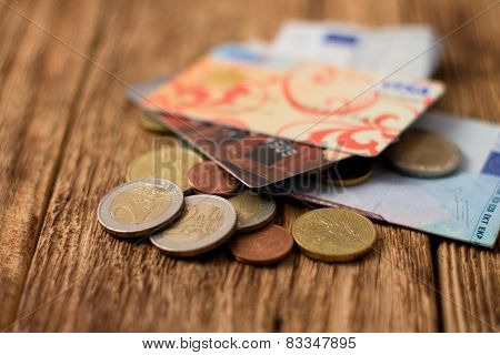 Heap Of Euro Bills And Coins With Two Credit Cards