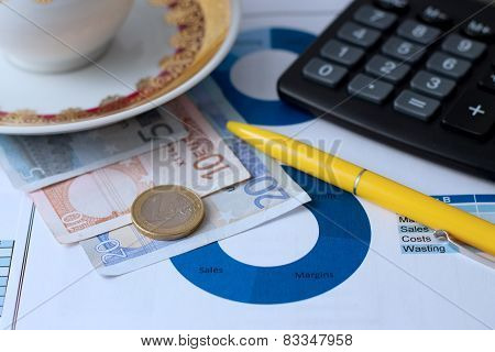One Euro Coin, Bills, Calculator And Pen