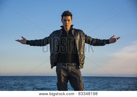 Young Man Celebrating Nature At The Seaside