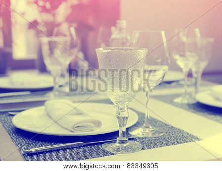 Nice place setting in an expensive restaurant, toned image