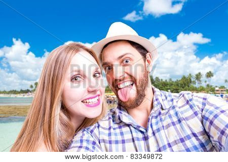 Beautiful Couple taking a selfie photo in the beach
