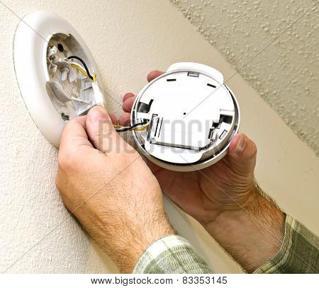 Smoke Detector Being Repaired
