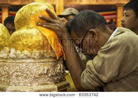 Buddhist Devotee Praying At Phaung Daw Oo Pagoda, Inle Lake, Myanmar