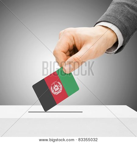 Voting Concept - Male Inserting Flag Into Ballot Box - Afghanistan