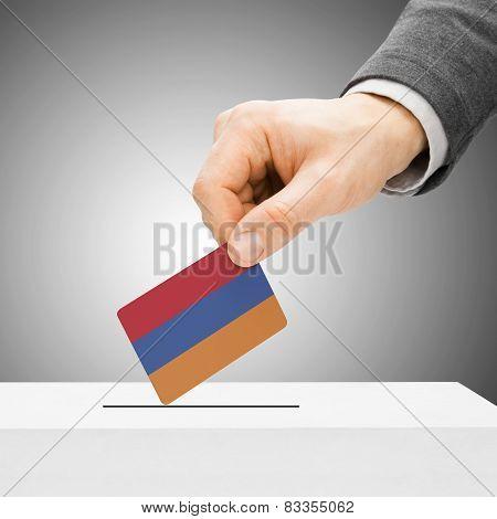Voting Concept - Male Inserting Flag Into Ballot Box - Armenia