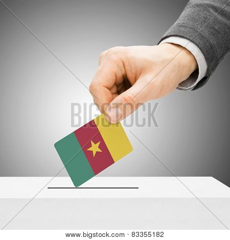 Voting Concept - Male Inserting Flag Into Ballot Box - Cameroon