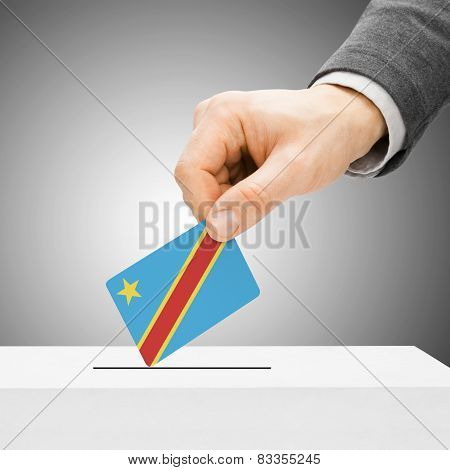 Voting Concept - Male Inserting Flag Into Ballot Box - Democratic Republic Of The Congo