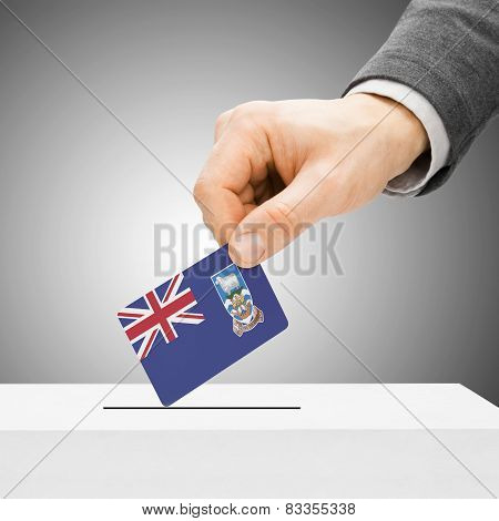 Voting Concept - Male Inserting Flag Into Ballot Box - Falkland Islands
