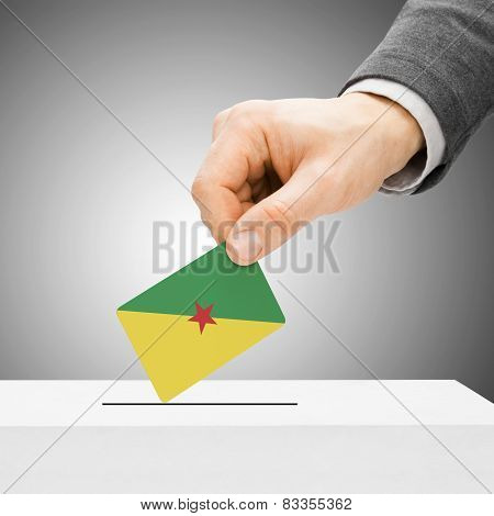 Voting Concept - Male Inserting Flag Into Ballot Box - French Guiana