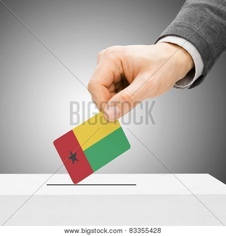 Voting Concept - Male Inserting Flag Into Ballot Box - Guinea-bissau