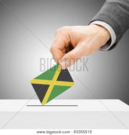 Voting Concept - Male Inserting Flag Into Ballot Box - Jamaica