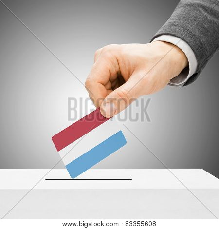 Voting Concept - Male Inserting Flag Into Ballot Box - Luxembourg