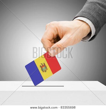 Voting Concept - Male Inserting Flag Into Ballot Box - Moldova