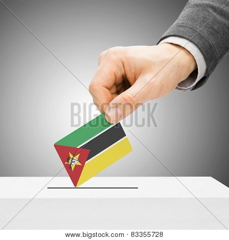 Voting Concept - Male Inserting Flag Into Ballot Box - Mozambique