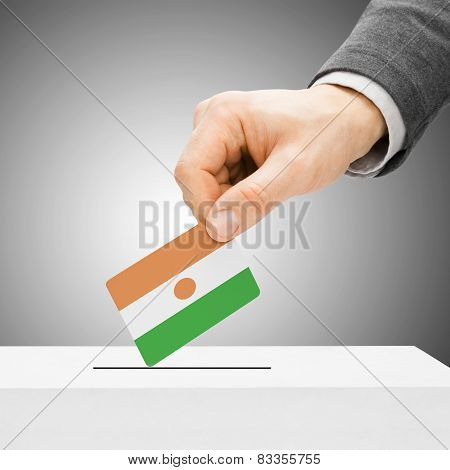 Voting Concept - Male Inserting Flag Into Ballot Box - Niger