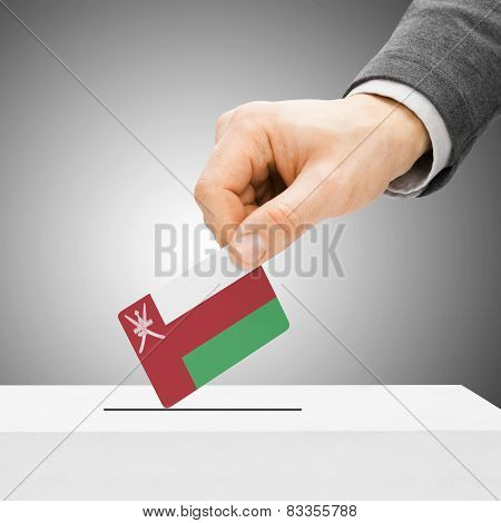 Voting Concept - Male Inserting Flag Into Ballot Box - Oman