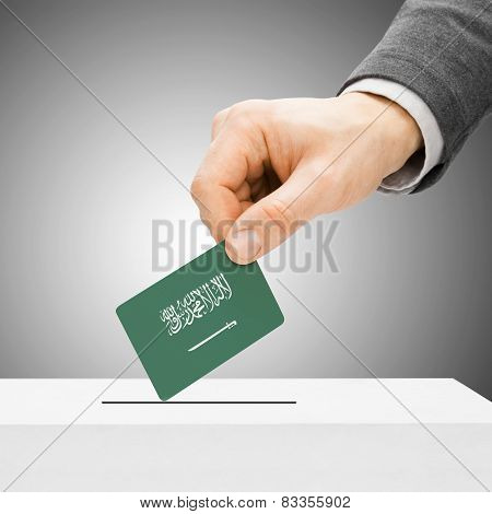 Voting Concept - Male Inserting Flag Into Ballot Box - Saudi Arabia