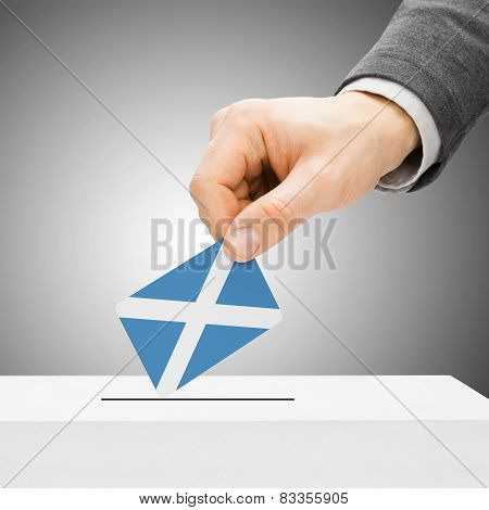 Voting Concept - Male Inserting Flag Into Ballot Box - Scotland