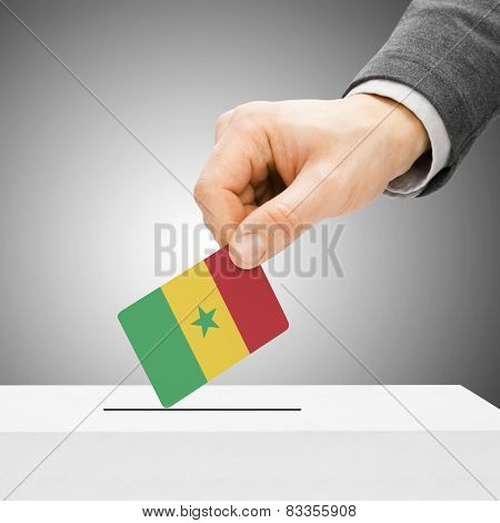 Voting Concept - Male Inserting Flag Into Ballot Box - Senegal