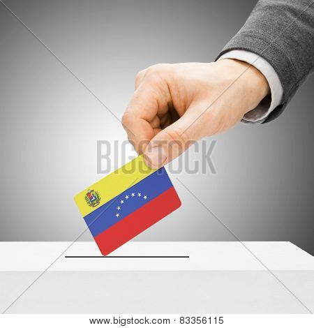 Voting Concept - Male Inserting Flag Into Ballot Box - Venezuela
