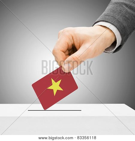 Voting Concept - Male Inserting Flag Into Ballot Box - Vietnam