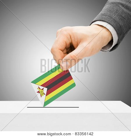 Voting Concept - Male Inserting Flag Into Ballot Box - Zimbabwe