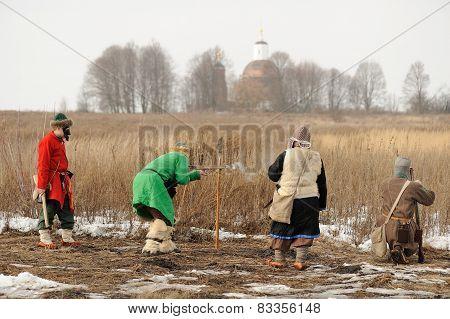 Men Wearing Folk Costumes And Masks During Winter Carnival Maslenitsa In Russia