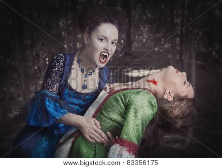 Beautiful Vampire Woman In Medieval Dress And Her Victim