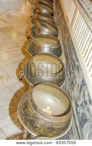 BANGKOK, THAILAND, DECEMBER 26, 2013: some of 108 bronze bowls indicating 108 auspicious characters of Buddha, Wat Pho temple