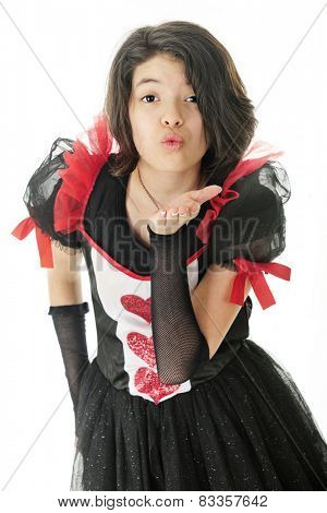 A beautiful young teen blowing a kiss to the viewer.  She wears a red, white and black valentine dress.  On a white background.