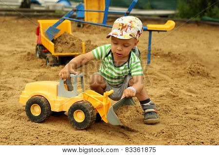 Little Boy In The Sandbox.