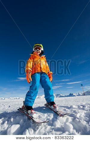 Smiling boy wearing ski mask and helmet in winter