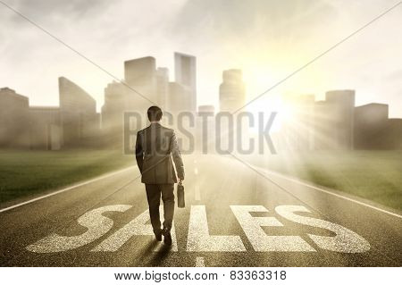 Salesman Walking Toward A City