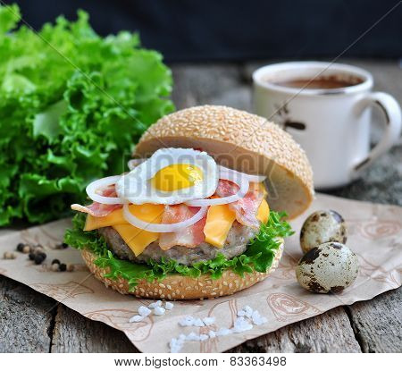 Hamburger, burger with an grilled beef, egg, bacon, cheese and onion