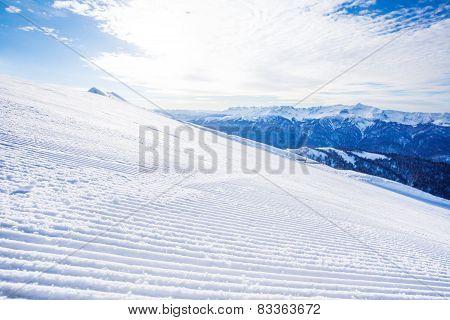 Winter landscape of ski-track and Caucasus hills