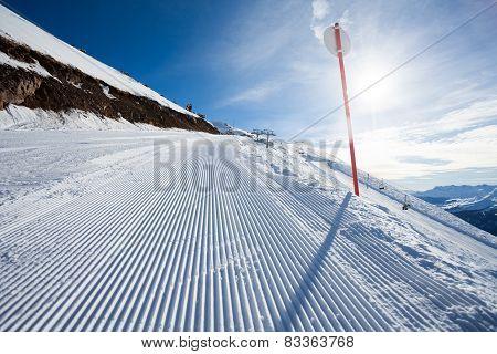 Winter landscape of long ski-track with sign
