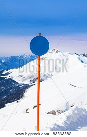 Round shaped attention sign on mountain landscape