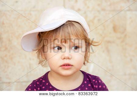 Caucasian Blond Baby Girl In Baseball Cap