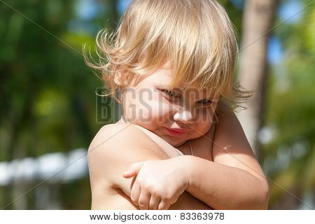 Cute Shy Caucasian Blond Baby Girl Portrait