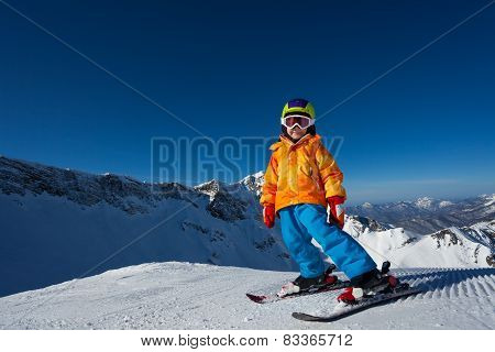 Boy in mask skiing on Krasnaya polyana ski resort
