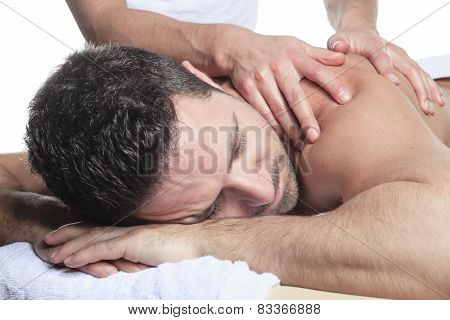Man receiving Shiatsu massage from a professional masseur at spa