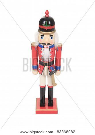 Antique Nutcracker Drummer with a red drum. He has white hair an