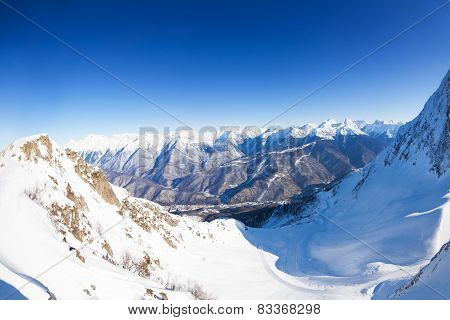 Panorama of snowy mountains from the peak in Sochi