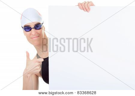 A woman swimmer in studio white background