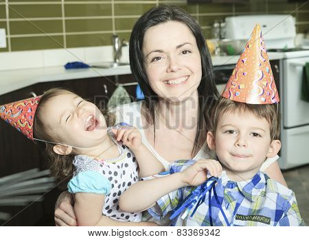 A Birthday Family with mother and children