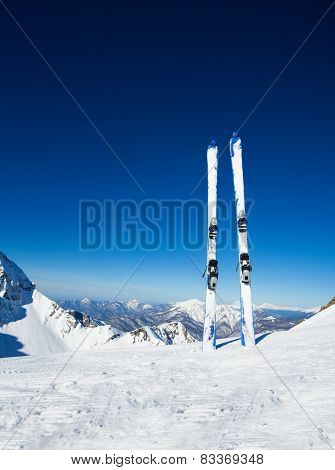 Two skies in snow on mountain ski resort